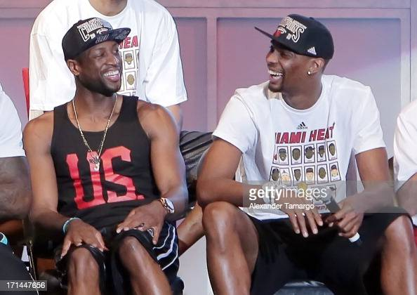 Dwyane Wade and Chris Bosh of the Miami Heat attend the NBA Championship victory rally at the AmericanAirlines Arena on June 24 2013 in Miami Florida...