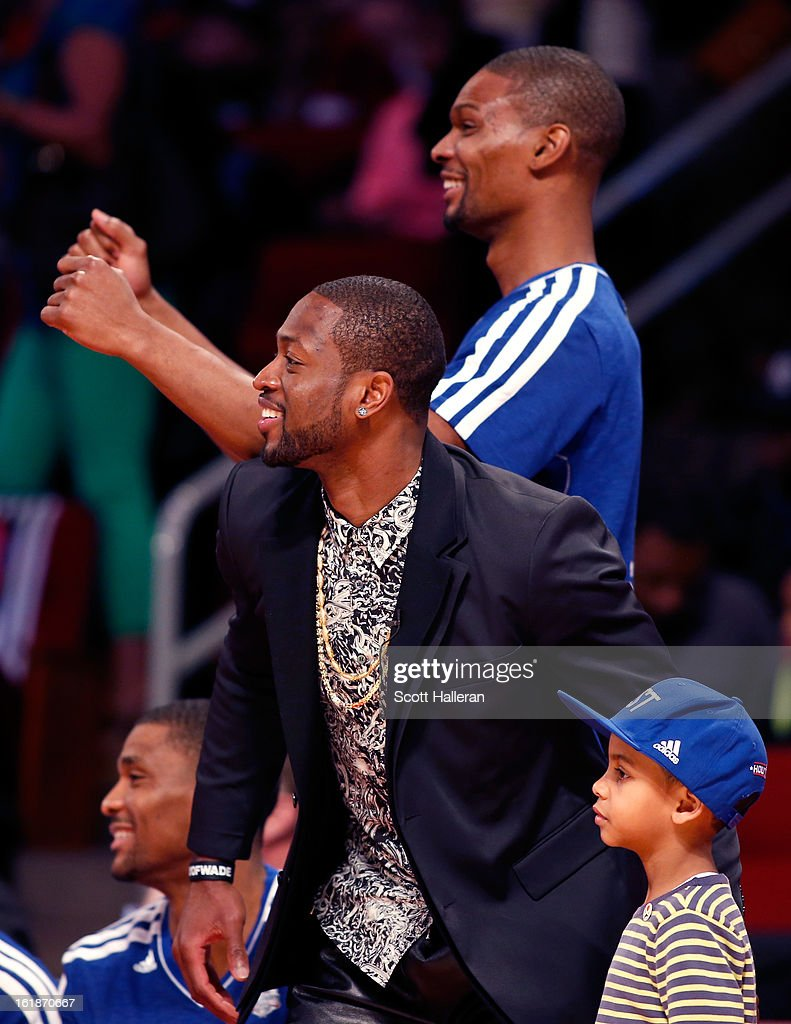 <a gi-track='captionPersonalityLinkClicked' href=/galleries/search?phrase=Dwyane+Wade&family=editorial&specificpeople=201481 ng-click='$event.stopPropagation()'>Dwyane Wade</a> and <a gi-track='captionPersonalityLinkClicked' href=/galleries/search?phrase=Chris+Bosh&family=editorial&specificpeople=201574 ng-click='$event.stopPropagation()'>Chris Bosh</a> of the Miami Heat cheer during the Sears Shooting Stars Competition part of 2013 NBA All-Star Weekend at the Toyota Center on February 16, 2013 in Houston, Texas.
