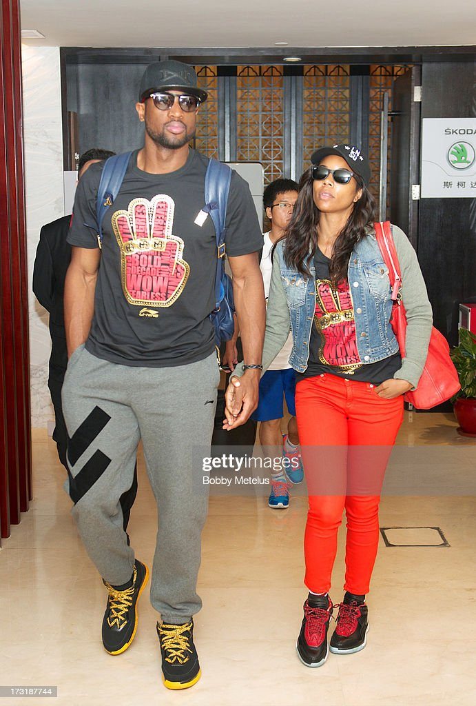 Dwyane Wade and Gabrielle Union arrive at Shanghai Airport to contuine Li-Ning ' Way of Wade' China tour on July 8, 2013 in Shanghai, China.