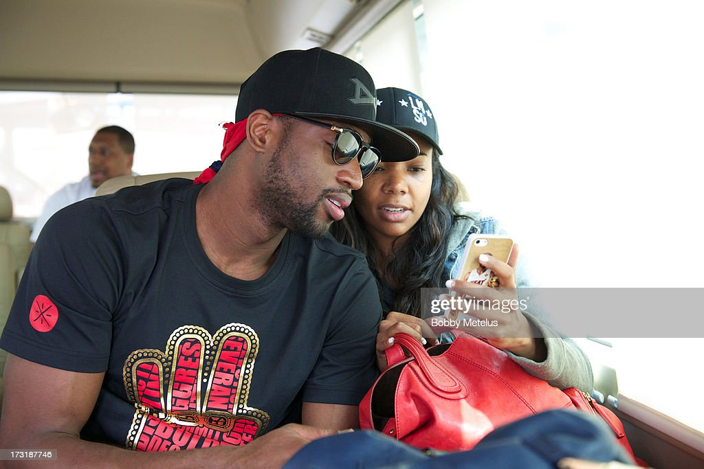 <a gi-track='captionPersonalityLinkClicked' href=/galleries/search?phrase=Dwyane+Wade&family=editorial&specificpeople=201481 ng-click='$event.stopPropagation()'>Dwyane Wade</a> and <a gi-track='captionPersonalityLinkClicked' href=/galleries/search?phrase=Gabrielle+Union&family=editorial&specificpeople=202066 ng-click='$event.stopPropagation()'>Gabrielle Union</a> arrive at Shanghai Airport to contuine Li-Ning ' Way of Wade' China tour on July 8, 2013 in Shanghai, China.