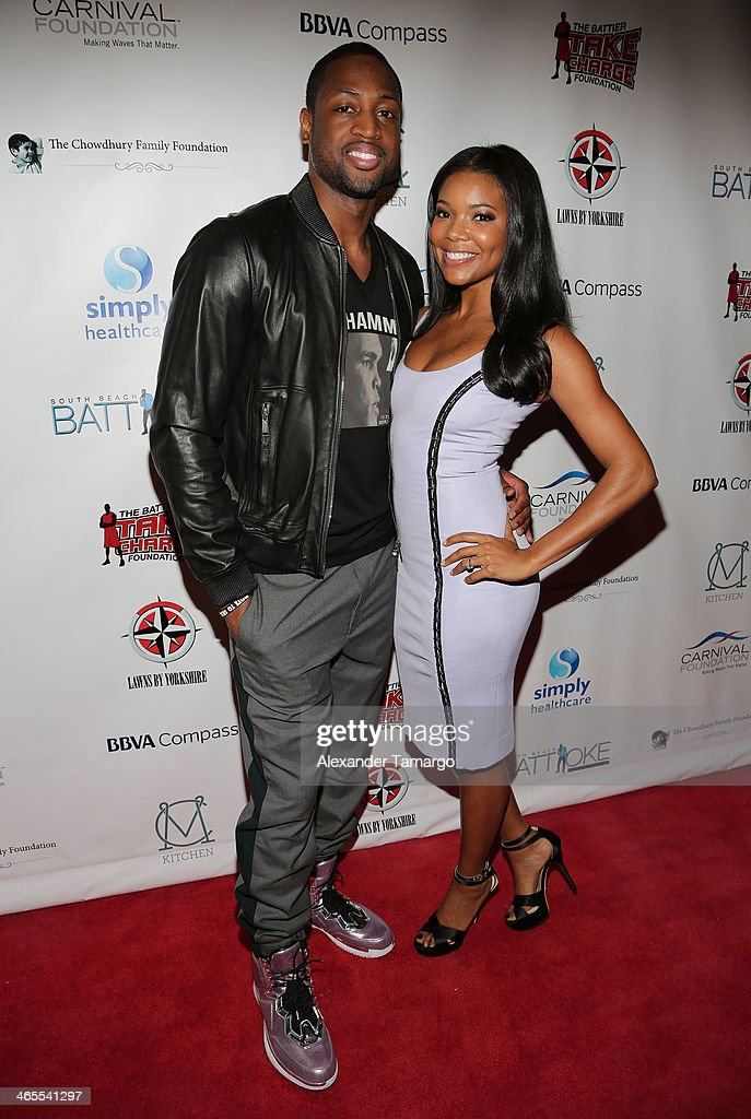 <a gi-track='captionPersonalityLinkClicked' href=/galleries/search?phrase=Dwyane+Wade&family=editorial&specificpeople=201481 ng-click='$event.stopPropagation()'>Dwyane Wade</a> and <a gi-track='captionPersonalityLinkClicked' href=/galleries/search?phrase=Gabrielle+Union&family=editorial&specificpeople=202066 ng-click='$event.stopPropagation()'>Gabrielle Union</a> arrive at South Beach Battioke 2014 at Fillmore Miami Beach on January 27, 2014 in Miami Beach, Florida.