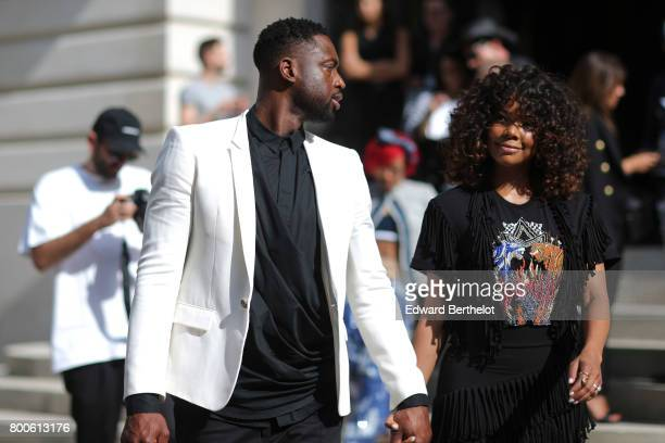 Dwyane Wade and Gabrielle Union attend the Balmain Menswear Spring/Summer 2018 show as part of Paris Fashion Week on June 24 2017 in Paris France