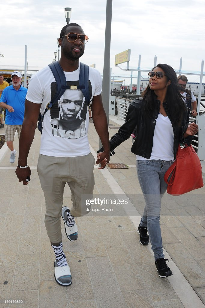 <a gi-track='captionPersonalityLinkClicked' href=/galleries/search?phrase=Dwyane+Wade&family=editorial&specificpeople=201481 ng-click='$event.stopPropagation()'>Dwyane Wade</a> and <a gi-track='captionPersonalityLinkClicked' href=/galleries/search?phrase=Gabrielle+Union&family=editorial&specificpeople=202066 ng-click='$event.stopPropagation()'>Gabrielle Union</a> is seen leaving the Venice Airport during The 70th Venice International Film Festival on September 1, 2013 in Venice, Italy.