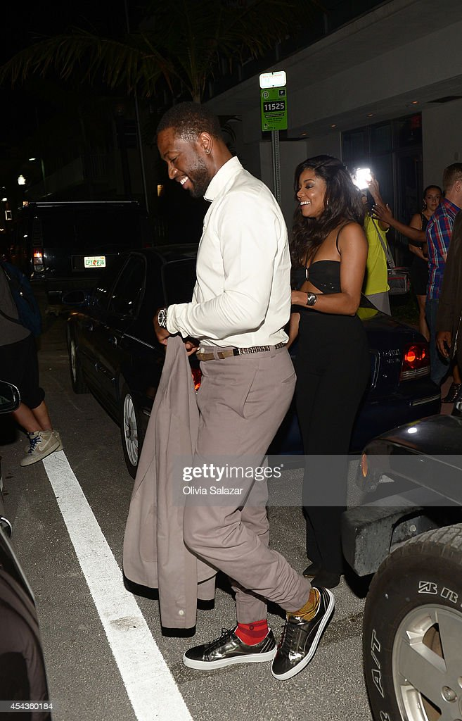 Dwyane Wade and Gabrielle Union leaves their wedding rehearsal dinner at Prime 112 Steakhouse on August 29, 2014 in Miami Beach, Florida.