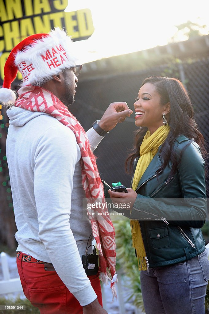 <a gi-track='captionPersonalityLinkClicked' href=/galleries/search?phrase=Dwyane+Wade&family=editorial&specificpeople=201481 ng-click='$event.stopPropagation()'>Dwyane Wade</a> and <a gi-track='captionPersonalityLinkClicked' href=/galleries/search?phrase=Gabrielle+Union&family=editorial&specificpeople=202066 ng-click='$event.stopPropagation()'>Gabrielle Union</a> make an appearance on behalf of Wade's World Foundation at Santa's Enchanted Forest on December 23, 2012 in Miami, Florida.