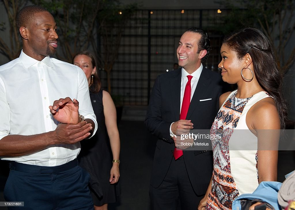 Dwyane Wade and Gabrielle Union share a laugh with SBE Group President Sam Bakhshandehpour (C) during the SLS Hotels China Branding Launch at the Key Club on July 10, 2013 in Shanghai, China, .