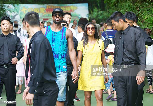 Dwyane Wade and Gabrielle Union visit Chimelong Safari Park on July 6 2013 in Guangzhou China