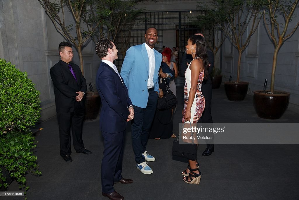 Dwyane Wade and Gabrielle Union with Director of Hotel Operations Michael Talansky during the SLS Hotels China Brand Launch at the Key Club on July 10, 2013 in Shanghai, China.