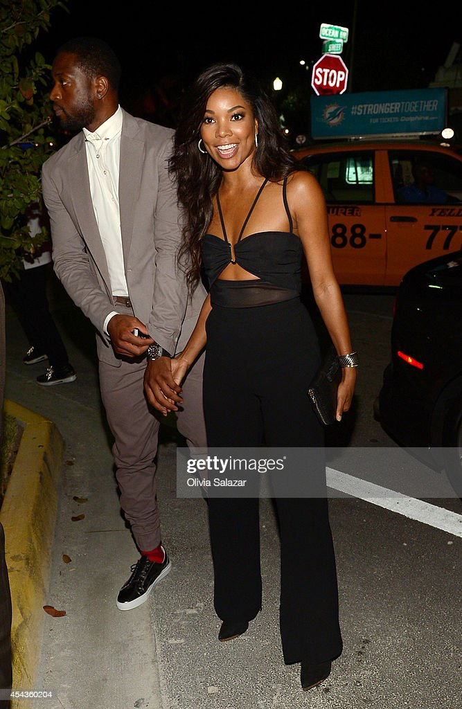 <a gi-track='captionPersonalityLinkClicked' href=/galleries/search?phrase=Dwyane+Wade&family=editorial&specificpeople=201481 ng-click='$event.stopPropagation()'>Dwyane Wade</a> and <a gi-track='captionPersonalityLinkClicked' href=/galleries/search?phrase=Gabrielle+Union&family=editorial&specificpeople=202066 ng-click='$event.stopPropagation()'>Gabrielle Union</a>arrives at their wedding rehearsal dinner at Prime 112 Steakhouse on August 29, 2014 in Miami Beach, Florida.