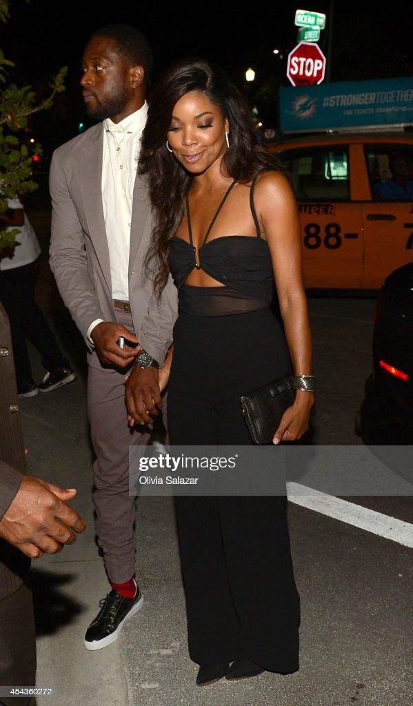 Dwyane Wade and Gabrielle Unionarrives at their wedding rehearsal dinner at Prime 112 Steakhouse on August 29, 2014 in Miami Beach, Florida.