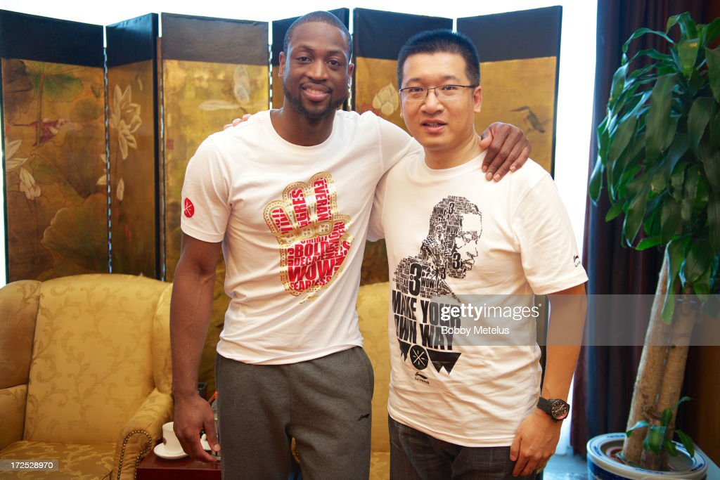 <a gi-track='captionPersonalityLinkClicked' href=/galleries/search?phrase=Dwyane+Wade&family=editorial&specificpeople=201481 ng-click='$event.stopPropagation()'>Dwyane Wade</a> and Head of Li-Ning Basketball, Gavin Yang on July 2, 2013 in Beijing, China.