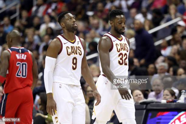 Dwyane Wade and Jeff Green of the Cleveland Cavaliers walk off the floor during a time out against the Washington Wizards at Capital One Arena on...