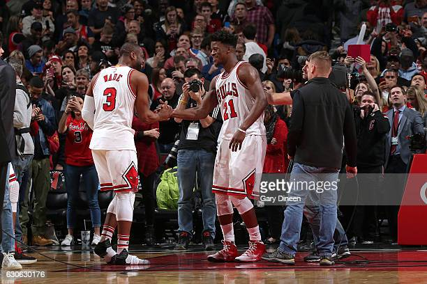 Dwyane Wade and Jimmy Butler of the Chicago Bulls celebrate after the game against the Brooklyn Nets on December 28 2016 at the United Center in...