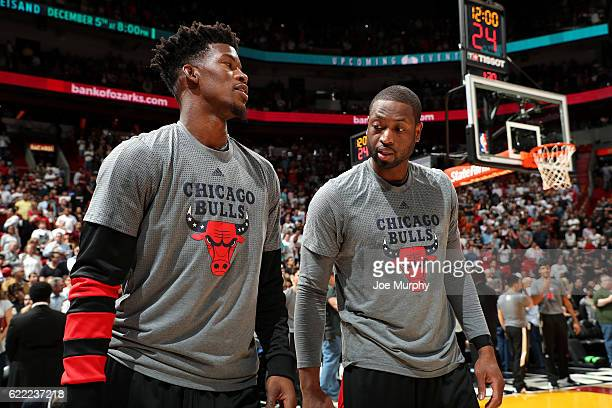 Dwyane Wade and Jimmy Butler of the Chicago Bulls looks on before the game against the Miami Heat on November 10 2016 at AmericanAirlines Arena in...
