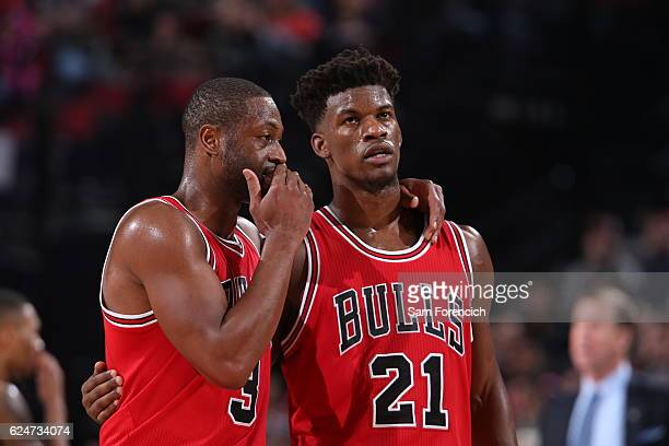 Dwyane Wade and Jimmy Butler of the Chicago Bulls talk during the game against the Portland Trail Blazers on November 15 2016 at the Moda Center...