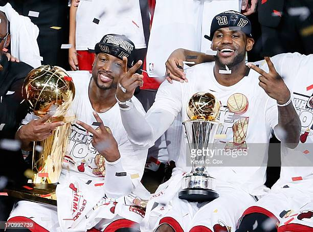 Dwyane Wade and LeBron James celebrate after defeating the San Antonio Spurs 9588 to win Game Seven of the 2013 NBA Finals at AmericanAirlines Arena...