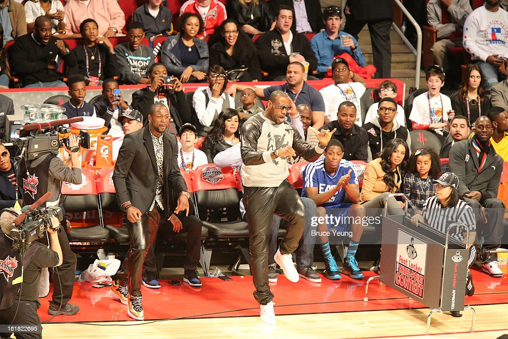 Dwyane Wade and LeBron James cheers during 2013 Foot Locker Three-Point Contest on State Farm All-Star Saturday Night as part of 2013 NBA All-Star Weekend on February 16, 2013 at Toyota Center in Houston, Texas.