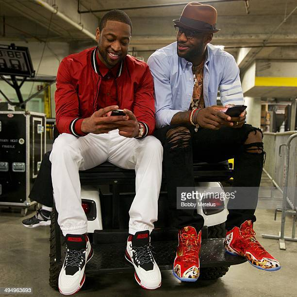 Dwyane Wade and LeBron James head to the podium after advancing to the NBA finals at AmericanAirlines Arena on May 30 2014 in Miami Florida