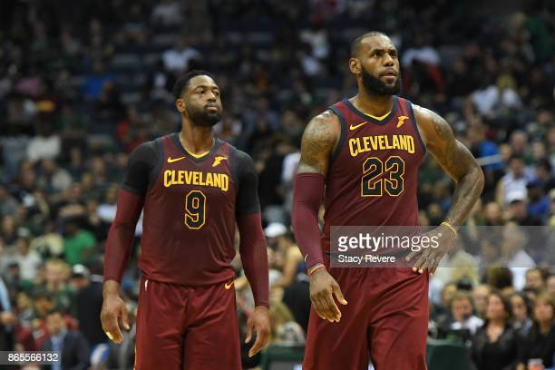 Dwyane Wade and LeBron James of the Cleveland Cavaliers walk backcourt during a game against the Milwaukee Bucks at the Bradley Center on October 20...