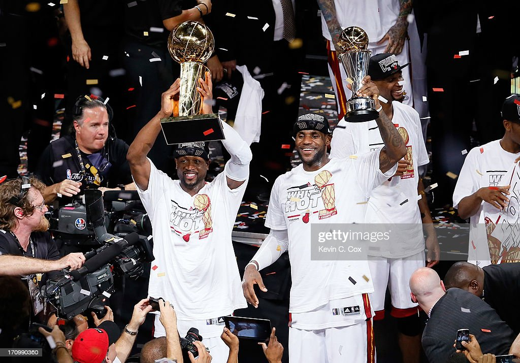 Dwyane Wade #3 and LeBron James #6 of the Miami Heat celebrate after defeating the San Antonio Spurs 95-88 to win Game Seven of the 2013 NBA Finals at AmericanAirlines Arena on June 20, 2013 in Miami, Florida.