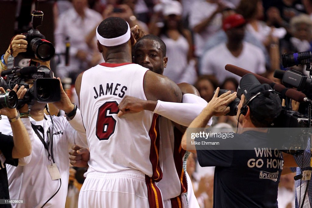 Dwyane Wade #3 and LeBron James #6 of the Miami Heat celebrate against the Chicago Bulls in Game Four of the Eastern Conference Finals during the 2011 NBA Playoffs on May 24, 2011 at American Airlines Arena in Miami, Florida. The Heat won 101-93 in overtime.