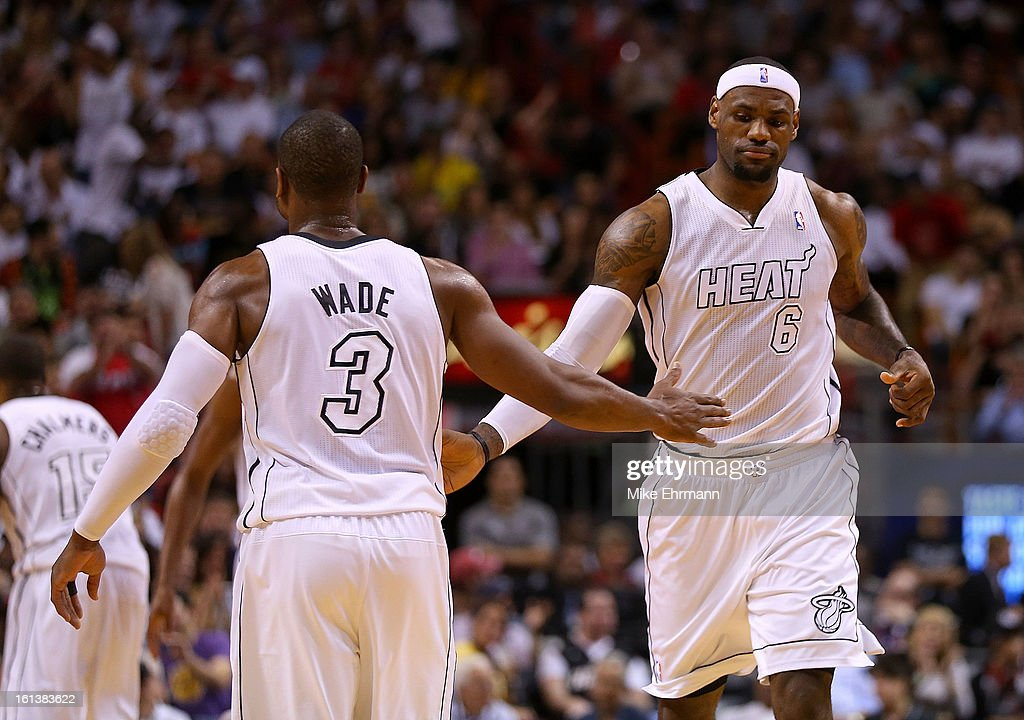Dwyane Wade #3 and LeBron James #6 of the Miami Heat high five during a game against the Los Angeles Lakers at American Airlines Arena on February 10, 2013 in Miami, Florida.