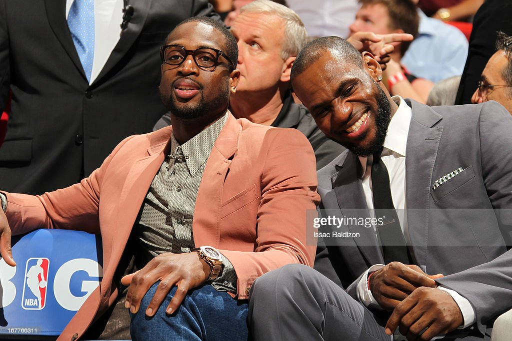 Dwyane Wade #3 and LeBron James #6 of the Miami Heat share a laugh on the bench during the game against the New York Knicks on April 2, 2013 at American Airlines Arena in Miami, Florida.