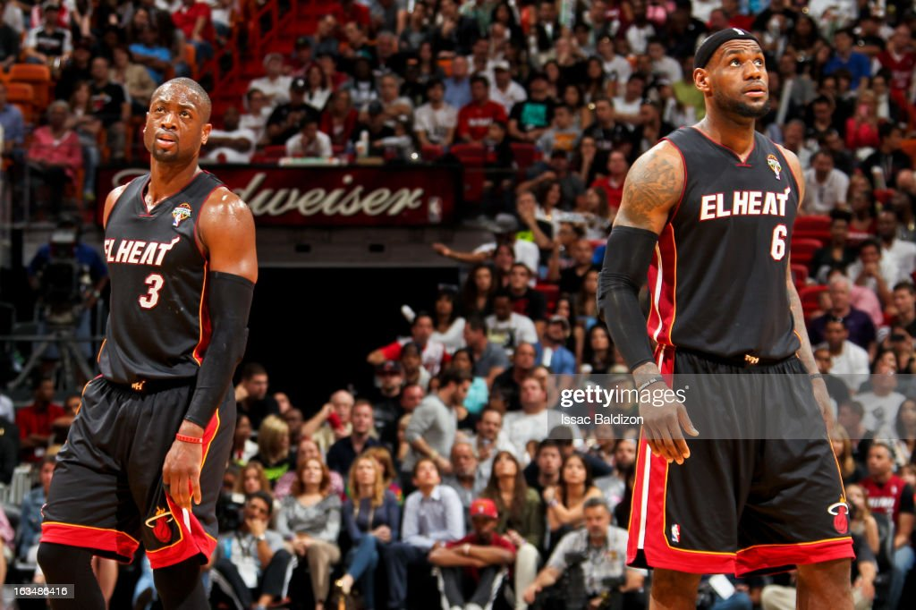 Dwyane Wade #3 and LeBron James #6 of the Miami Heat wait to resume play action against the Indiana Pacers on March 10, 2013 at American Airlines Arena in Miami, Florida.