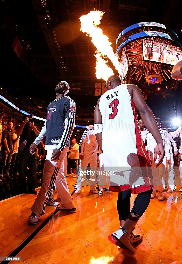 Dwyane Wade #3 and LeBron James #6 of the Miami Heat warm up during a game against the Chicago Bulls at AmericanAirlines Arena on January 4, 2013 in Miami, Florida.