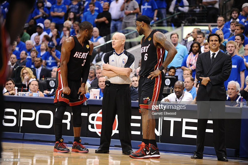 Dwyane Wade #3 and LeBron James #6 talk with referee Joey Crawford during Game Five of the 2011 NBA Finals against the Dallas Mavericks on June 9, 2011 at the American Airlines Center in Dallas, Texas.