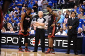 Dwyane Wade and LeBron James talk with referee Joey Crawford during Game Five of the 2011 NBA Finals against the Dallas Mavericks on June 9 2011 at...