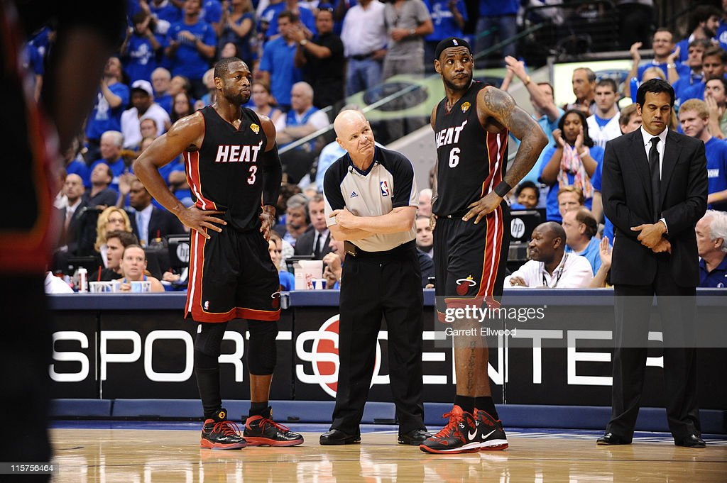 Dwyane Wade #3 and LeBron James #6 with referee Joey Crawford during Game Five of the 2011 NBA Finals against the Dallas Mavericks on June 9, 2011 at the American Airlines Center in Dallas, Texas.