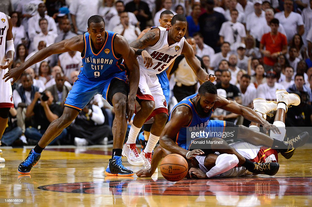Dwyane Wade and Mario Chalmers of the Miami Heat chase down a loose ball in the first half against James Harden and Serge Ibaka of the Oklahoma City...
