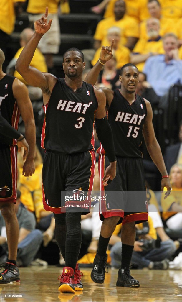 Dwyane Wade and Mario Chalmers of the Miami Heat celebrate after Wade hit a shot and was fouled against the Indiana Pacers in Game Six of the Eastern...