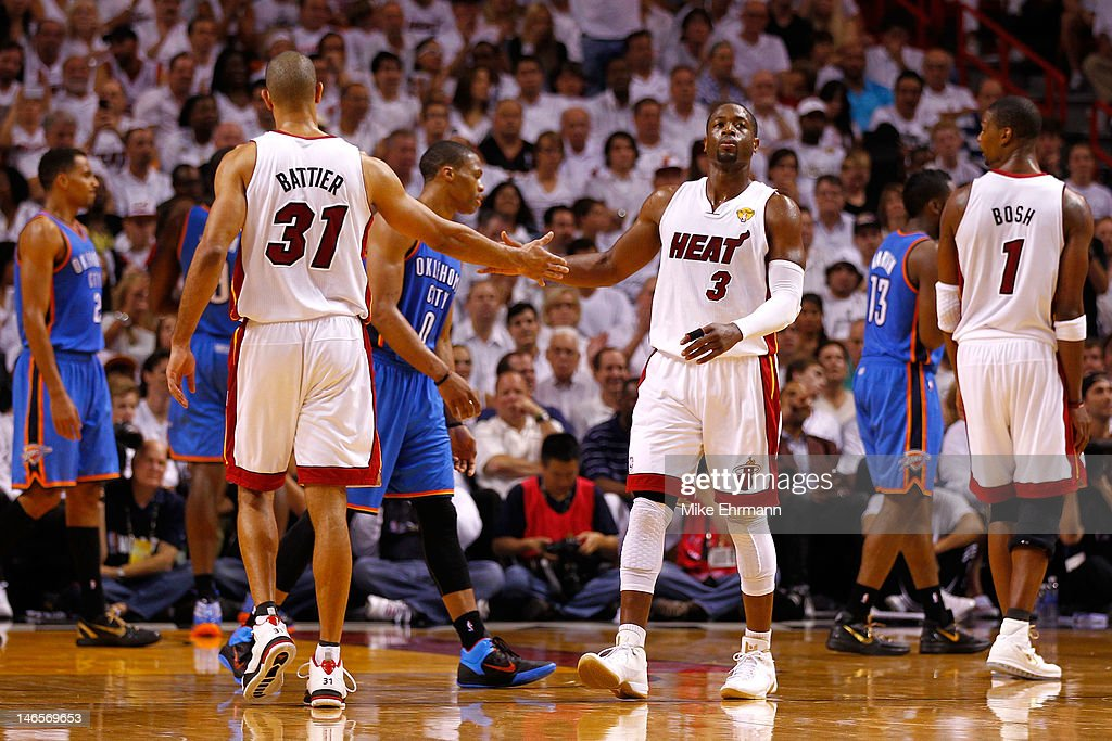 Dwyane Wade #3 and Shane Battier #31 of the Miami Heat react after an offensive play in the second half against the Oklahoma City Thunder in Game Four of the 2012 NBA Finals on June 19, 2012 at American Airlines Arena in Miami, Florida.