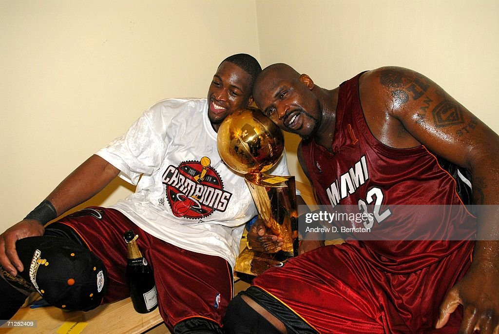 Dwyane Wade and Shaquille O'Neal of the Miami Heat celebrate with the Larry O'Brien Championship trophy after their Game Six victory of the 2006 NBA...