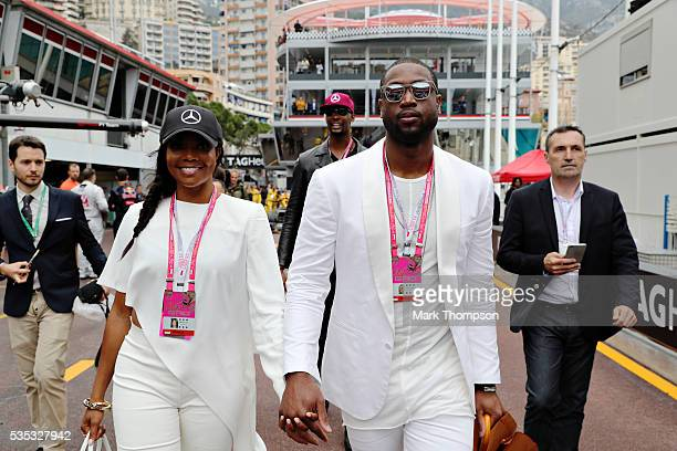 Dwayne Wade basketball player and Gabriella Union actor walk in the Pitlane during the Monaco Formula One Grand Prix at Circuit de Monaco on May 29...
