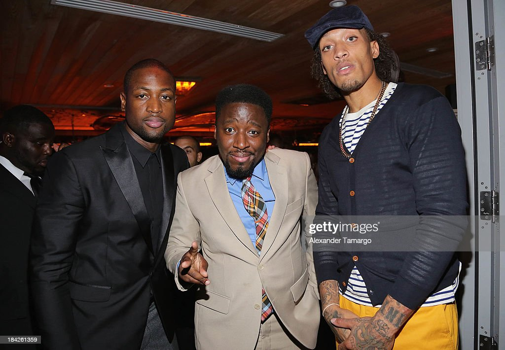 Dwyane Wade, Bob Metelus and Michael Beasley attend the 'GQ Men' Book celebration presented by Hennessy on October 12, 2013 in Miami, Florida.