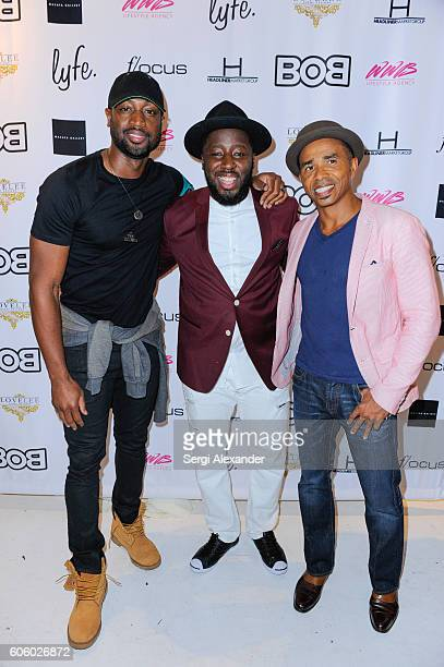 Dwyane Wade Bob Metelus and Patrick Glemaud attend Haitian photographer Bob Metelus unveils newest collection Haiti A Collective Cry from a Forgotten...