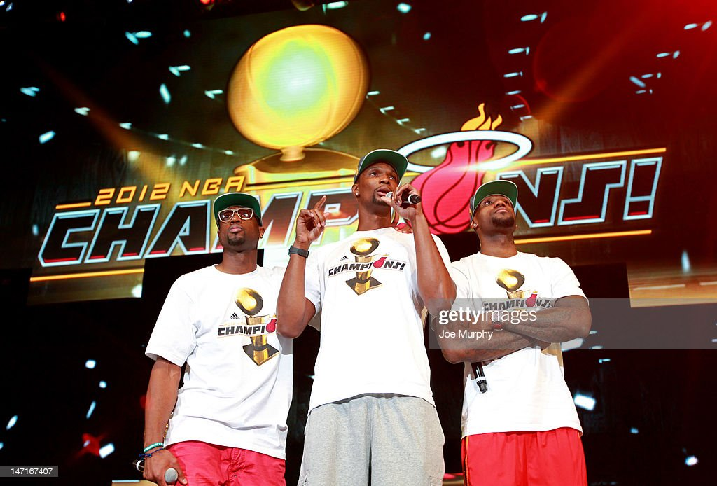 Dwyane Wade #3, Chris Bosh #1 and LeBron James #6 of the Miami Heat speak to the crowd during a rally for the 2012 NBA Champions Miami Heat on June 25, 2012 at American Airlines Arena in Miami, Florida.