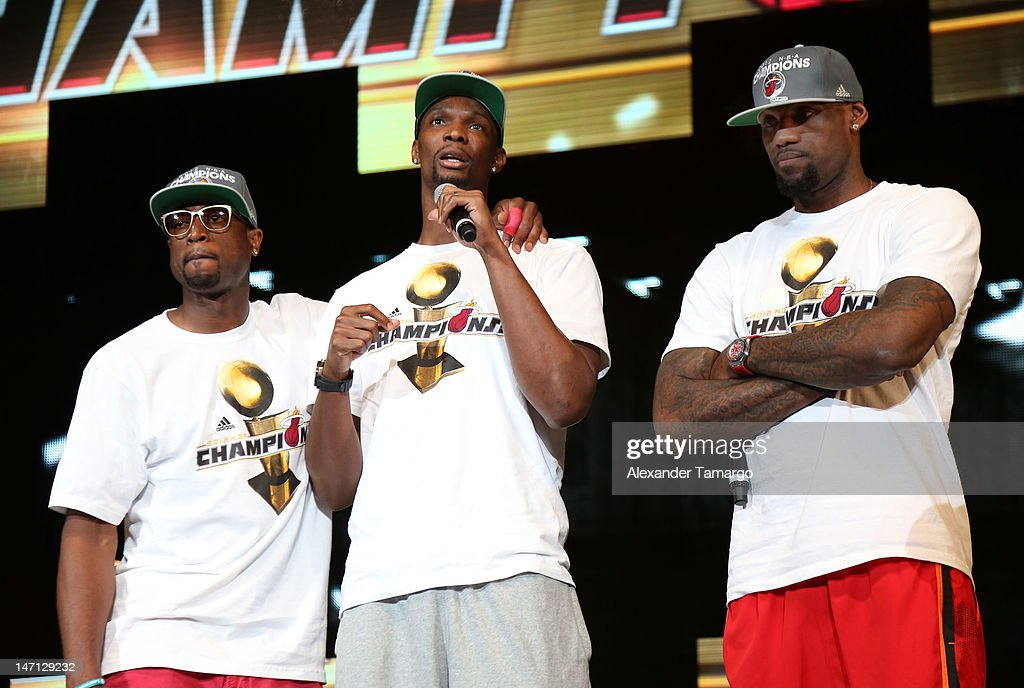 <a gi-track='captionPersonalityLinkClicked' href=/galleries/search?phrase=Dwyane+Wade&family=editorial&specificpeople=201481 ng-click='$event.stopPropagation()'>Dwyane Wade</a>, <a gi-track='captionPersonalityLinkClicked' href=/galleries/search?phrase=Chris+Bosh&family=editorial&specificpeople=201574 ng-click='$event.stopPropagation()'>Chris Bosh</a> and <a gi-track='captionPersonalityLinkClicked' href=/galleries/search?phrase=LeBron+James&family=editorial&specificpeople=201474 ng-click='$event.stopPropagation()'>LeBron James</a> participate in the Miami Heat 2012 NBA Championship Celebration at AmericanAirlines Arena on June 25, 2012 in Miami, Florida.