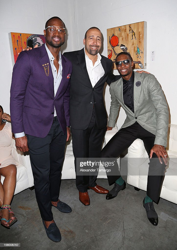 <a gi-track='captionPersonalityLinkClicked' href=/galleries/search?phrase=Dwyane+Wade&family=editorial&specificpeople=201481 ng-click='$event.stopPropagation()'>Dwyane Wade</a>, David Fizdale and <a gi-track='captionPersonalityLinkClicked' href=/galleries/search?phrase=Chris+Bosh&family=editorial&specificpeople=201574 ng-click='$event.stopPropagation()'>Chris Bosh</a> make an appearance as Premier Beverage Hosts Art Of Basketball: Heat Wave With <a gi-track='captionPersonalityLinkClicked' href=/galleries/search?phrase=Dwyane+Wade&family=editorial&specificpeople=201481 ng-click='$event.stopPropagation()'>Dwyane Wade</a> & <a gi-track='captionPersonalityLinkClicked' href=/galleries/search?phrase=Chris+Bosh&family=editorial&specificpeople=201574 ng-click='$event.stopPropagation()'>Chris Bosh</a> on December 7, 2012 in Miami, Florida.