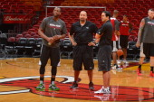 Dwyane Wade David Fizdale assistant coach and Erik Spoelstra head coach of the Miami Heat warm up at practice as part of the 2013 NBA Finals on June...