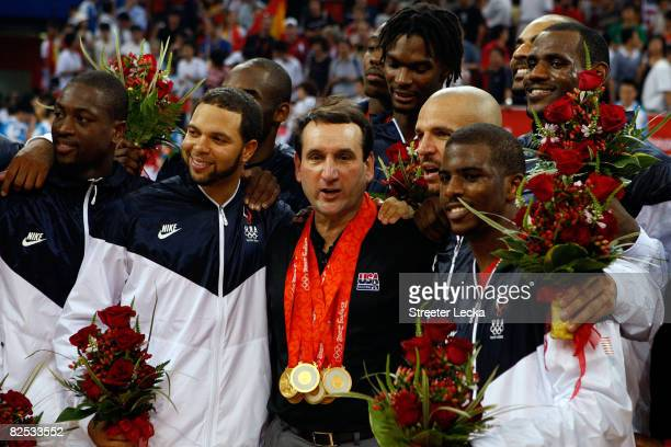 Dwyane Wade Deron Williams head coach Mike Krzyzewski Jason Kidd and Chris Paul of the United States pose for photos after defeating Spain in the...