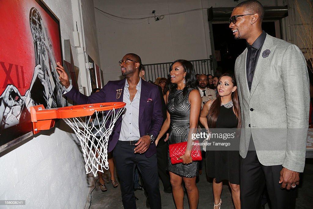 Dwyane Wade, Gabrielle Union, Adrienne Bosh and Chris Bosh make an appearance as Premier Beverage Hosts Art Of Basketball: Heat Wave With Dwyane Wade & Chris Bosh on December 7, 2012 in Miami, Florida.