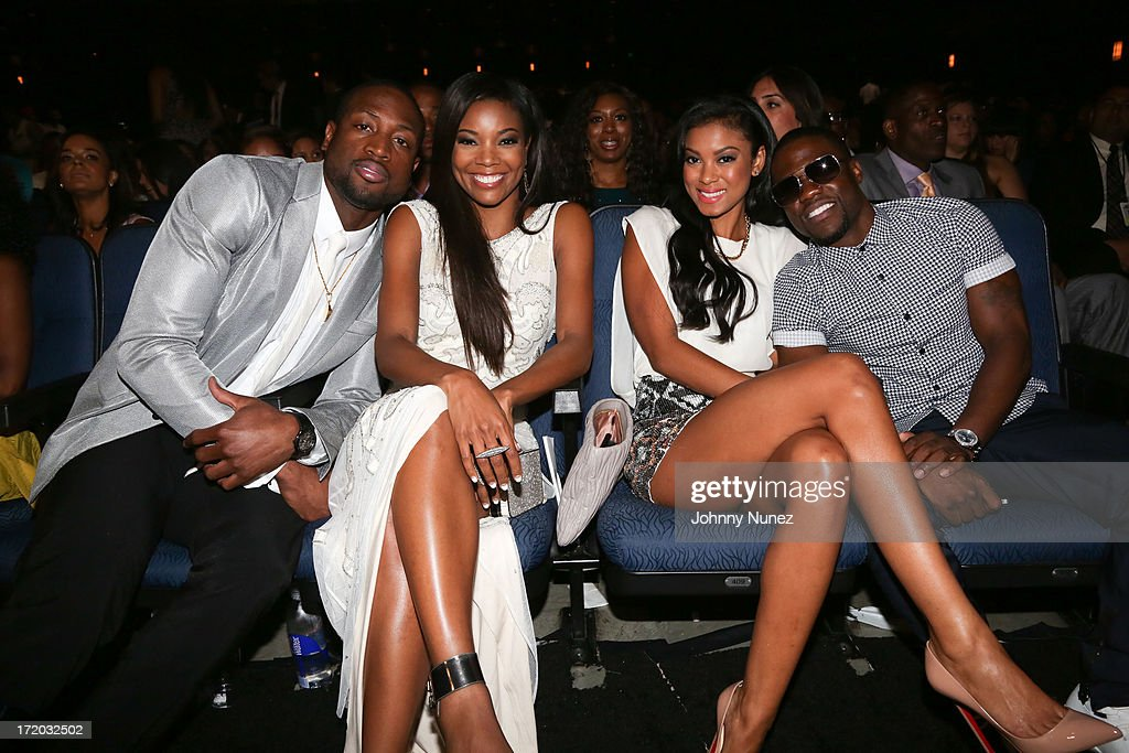 <a gi-track='captionPersonalityLinkClicked' href=/galleries/search?phrase=Dwyane+Wade&family=editorial&specificpeople=201481 ng-click='$event.stopPropagation()'>Dwyane Wade</a>, <a gi-track='captionPersonalityLinkClicked' href=/galleries/search?phrase=Gabrielle+Union&family=editorial&specificpeople=202066 ng-click='$event.stopPropagation()'>Gabrielle Union</a>, Eniko Parrish and <a gi-track='captionPersonalityLinkClicked' href=/galleries/search?phrase=Kevin+Hart+-+Actor&family=editorial&specificpeople=4538838 ng-click='$event.stopPropagation()'>Kevin Hart</a> attend 2013 BET Awards at Nokia Plaza L.A. LIVE on June 30, 2013 in Los Angeles, California.
