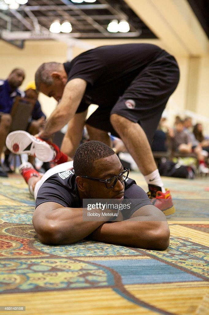 <a gi-track='captionPersonalityLinkClicked' href=/galleries/search?phrase=Dwyane+Wade&family=editorial&specificpeople=201481 ng-click='$event.stopPropagation()'>Dwyane Wade</a> gets help stretching at <a gi-track='captionPersonalityLinkClicked' href=/galleries/search?phrase=Dwyane+Wade&family=editorial&specificpeople=201481 ng-click='$event.stopPropagation()'>Dwyane Wade</a>'s Fourth Annual Fantasy Basketball Camp at Westin Diplomat on August 3, 2014 in Hollywood, Florida.