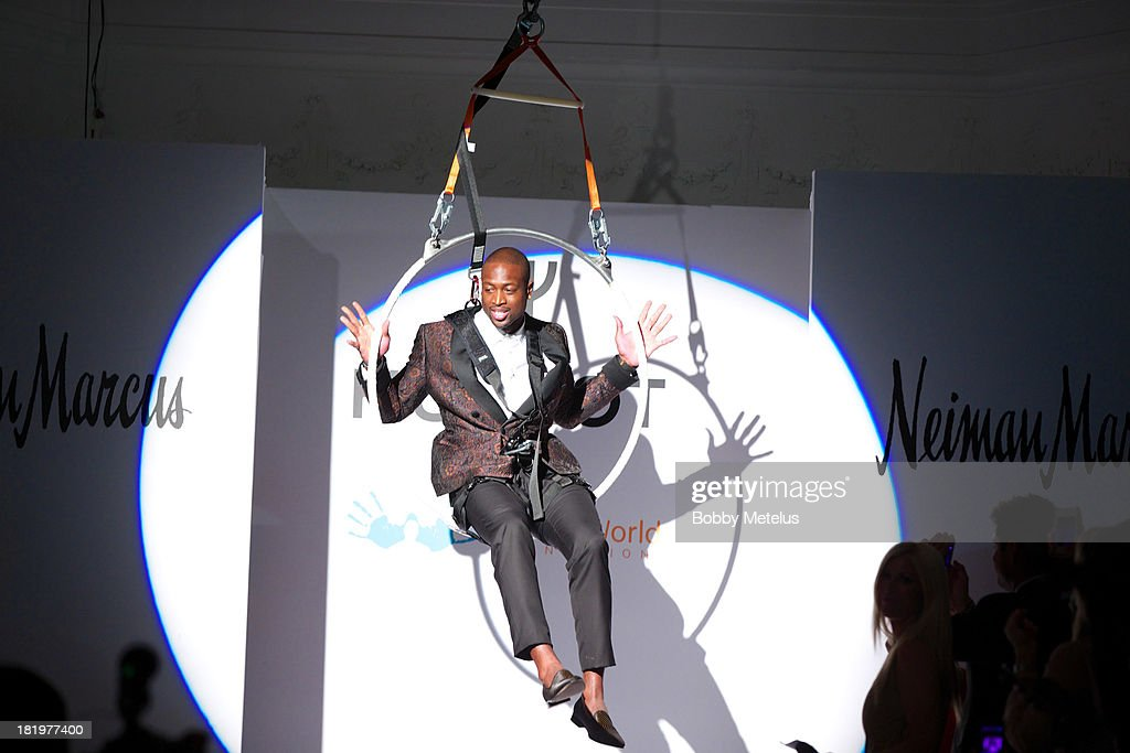 Dwyane Wade hangs on a trapeze at NBA Champion Dwyane Wade's Night On The RunWade to benefit Wade's World Foundation on September 26, 2013 in Miami, Florida.