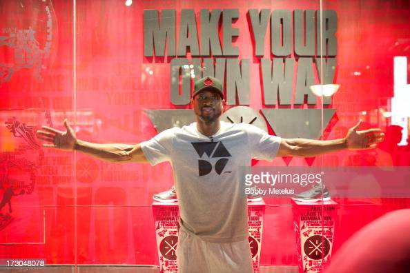 Dwyane Wade in front of LiNing 'Way of Wade' window display on July 4 2013 in Beijing China