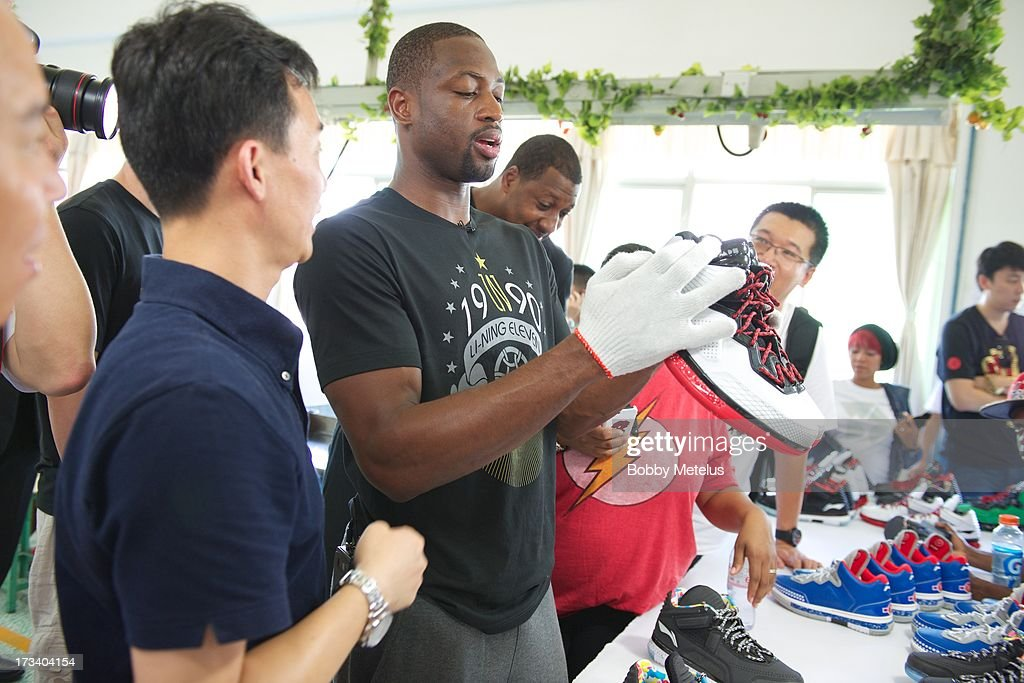 Dwyane Wade inspects a new batch of 'Way of Wade' shoes for quality control at the Li-Ning shoe manucaturing factory on July 12, 2013 in Tai Cang, China.
